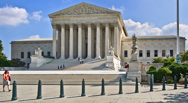 A particularly striking example is the U.S. Supreme Court building in  Washingon. Designed by Cass Gilbert and completed in 1935, the core of the  building ...