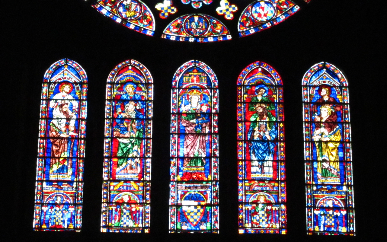 the stained glass chartres Although chartres' stained glass depends chiefly upon reds and blues, in bourges, pure whites, yellows and greens are prominent  quarried backgrounds with a.